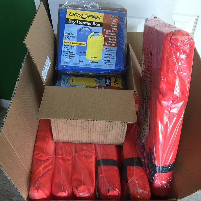 Box of life vests and dry storage bags